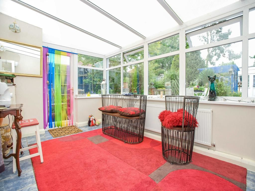 conservatory with door leading to the garden. Radiator. Wall lights - Wall lights, LED bathroom ...